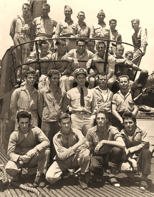 USS Tang (SS-306)The submarine's Commanding Officer, Lieutenant Commander Richard H. O'Kane (center), poses with the twenty-two aircrewmen that Tang rescued off Truk during the carrier air raids there on 29 April-1 May 1944. The photograph was taken upon Tang's return to Pearl Harbor from her second war patrol, in May 1944. Official U.S. Navy Photograph, now in the collections of the National Archives.