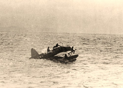 "Vought OS2U ""Kingfisher"" floatplane, from USS North Carolina (BB-55)Off Truk with nine aviators on board, awaiting rescue by USS Tang (SS-306), 1 May 1944. The plane had landed inside Truk lagoon to recover downed airmen. Unable to take off with such a load, it then taxiied out to Tang, which was serving as lifeguard submarine during the 29 April-1 May carrier strikes on Truk. Official U.S. Navy Photograph, now in the collections of the National Archives."