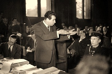 Well dressed and well groomed, the charismatic Kravchenko makes a typically vigorous intervention in the Paris courtroom in which his civil action against Les Lettres française was being heard. The protracted trial regularly drew standing-room-only crowds of spectators. Though Kravchenko won only the symbolic judgment of a single franc, the propaganda damage he inflicted on the French Communist Party was enormous.