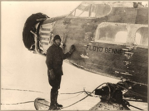 "Elbert J. Thawley, engineer of the ""Eleanor Bolling,"" standing beside the fuselage of the huge tri-motored Ford plane ""Floyd Bennett,"" before the ship was transported to Little America, the permanent base of the party"
