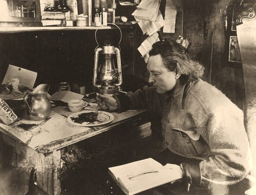Richard E. Byrd, USN Eating in his shack at Little America, Antarctica, circa late October 1934. He was rescued earlier that month from his advance base, where he had been in isolation for a little bit longer than two months. This picture was taken before he had his hair cut...   U.S. Naval History and Heritage Command Photograph