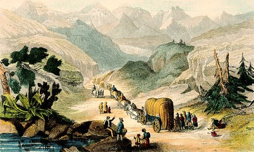 Wagon train of women, men, and children, moving through the mountains.