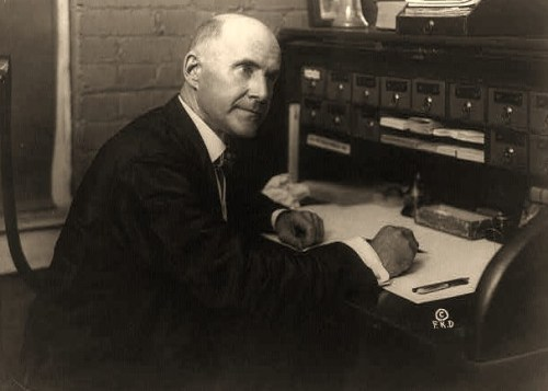 Eugene V. Debs, seated at desk would campaign from prison and still garner nearly a million votes