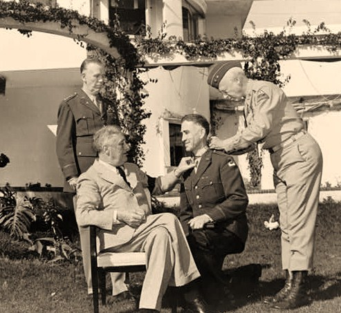 Casablanca conference at Casablanca, Morocco, President Roosevelt with Major General George S. Patton, Jr., affixing the Congressional Medal of Honor upon Brig. General William H. Wilbur in the presence of General George C. Marshall