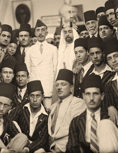King Feisal's last visit to Jerusalem. Late King Feisal and Emir Abdullah. Surrounded by the students near the Dome of the Rock