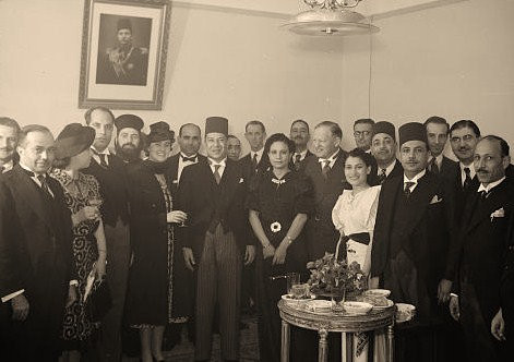 King Farouk's birthday celebrations in J'lem. [i.e., Jerusalem]. Group in the reception room, with Egyptian Counsel Gen[eral] Moh. Khayrat Bey