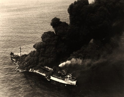 MS Pennsylvania Sun (U.S. Merchant Tanker, 1938) Burning after she was torpedoed by the German Submarine U-571 about 125 miles west of Key West, Florida, on 15 July 1942. Photographed from a Naval Air Station, Key West, aircraft. Pennsylvania Sun was saved and returned to service. Official U.S. Navy Photograph, now in the collections of the National Archives.