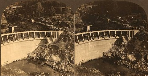 Stereograph showing view from elevated vantage point of the Kerckoff Dam and spillway.