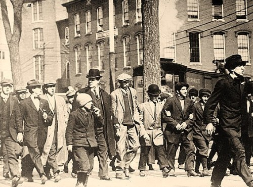 Photo shows William Dudley (Big Bill) Haywood, an American labor movement leader, marching with strikers in Lowell, Massachusetts.