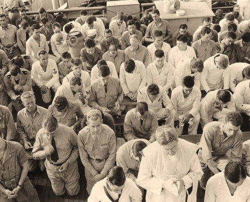 USS Ancon (AGC-4)Catholic church services being held on board off Mers el Kebir, Algeria, on 4 July 1943, just before the invasion of Sicily. Official U.S. Navy Photograph, now in the collections of the National Archives.