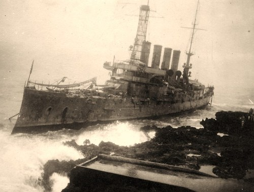USS Memphis (Armored Cruiser # 10)Wrecked at Santo Domingo, Dominican Republic, where she was thrown ashore by tidal waves on the afternoon of 29 August 1916. This view probably was taken early on 30 August, as the ship appears to be abandoned. Note the anchor chain running seaward from her starboard bow. U.S. Naval Historical Center Photograph.