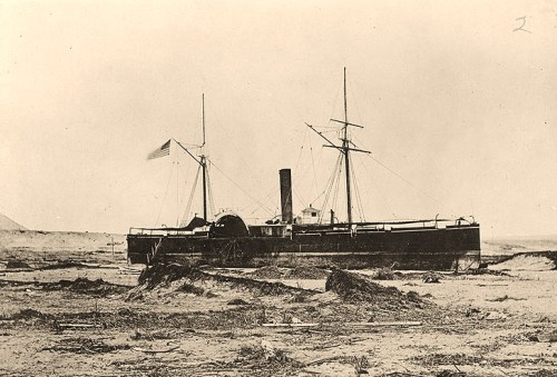 USS Wateree (1864-1868)Beached at Arica, Chile, 430 yards above the usual high water mark, after she was deposited there by a tidal wave on 13 August 1868. Her iron hull was reasonably intact, but salvage was not economical, and she was sold where she lay. Courtesy of Murray Greene Day. U.S. Naval Historical Center Photograph.