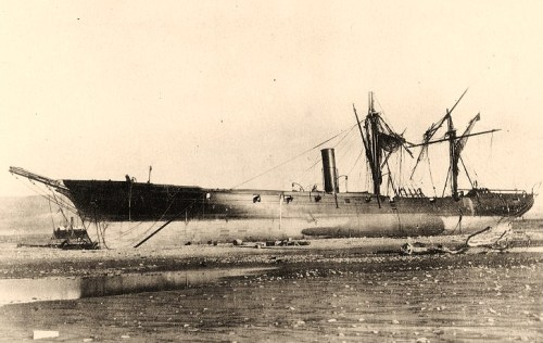 America (Peruvian Warship)Beached and partially dismasted at Arica, Chile, following the 13 August 1868 tidal wave that washed her and other vessels ashore. Photographed from the seaward side. Ship in the distance, beyond America's bow, is USS Wateree. This photograph was received from Captain Dudley W. Knox in 1934. U.S. Naval Historical Center Photograph.