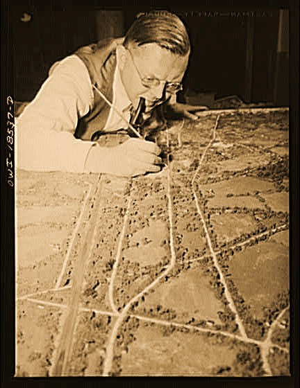 New York, New York. Architect taking a night course in camouflage at New York University in order to find a good spot for his talents in the United States Army or in industry. The class is taught by having the students make models from photographs, camouflage them and rephotograph them