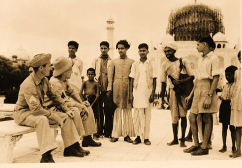 Agra (vicinity), India. The curiosity is mutual as American Sergeants Robert L. Snyder and LeRoy R. Bergin and the natives look each other over during a day of sightseeing at the Taj Mahal