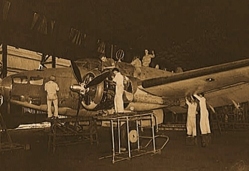 "United States ""lend-lease"" program in eastern India. A mixed crew of English, Chinese and Indian workmen repair a lend-lease Hudson bomber which was shot up and damaged too badly for field repairs during a bombing raid on the Japanese occupied portion of Akyab, an island off the coast of Burma. The crew named the bomber ""Lulu"""
