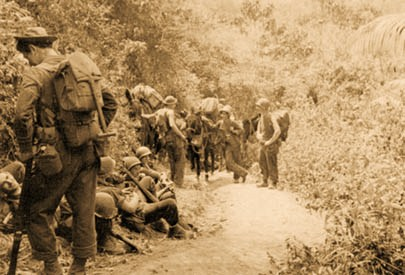 Marauders rest during a break along a jungle trail near Nhpum Ga.(Department of the Army photograph)
