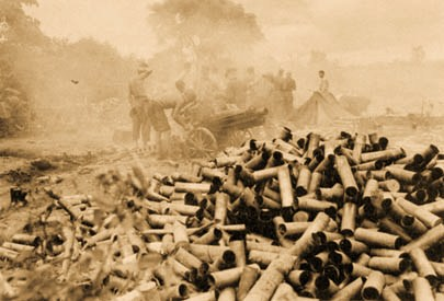 A 75-mm. pack howitzer supports GALAHAD's siege operations at Myitkyina. (Department of the Army photograph)