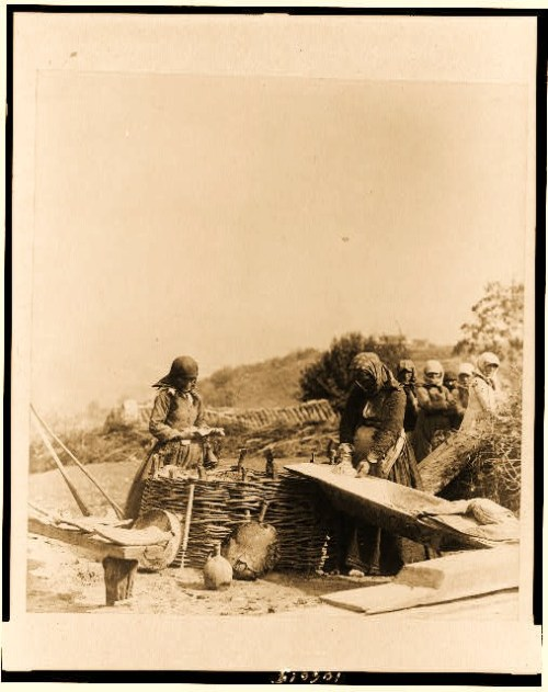 Women baking bread outdoors, Caucasus, Georgia (Republic)