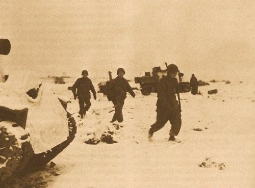 PARATROOPERS OF THE 101ST AIRBORNE MOVING UP TO BASTOGNE