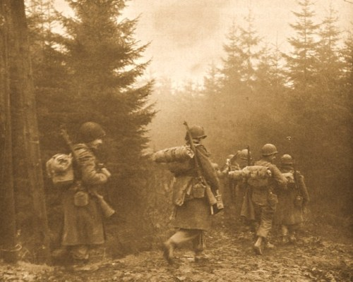TROOPS OF 325TH GLIDER INFANTRY MOVING THROUGH FOG TO A NEW POSITION