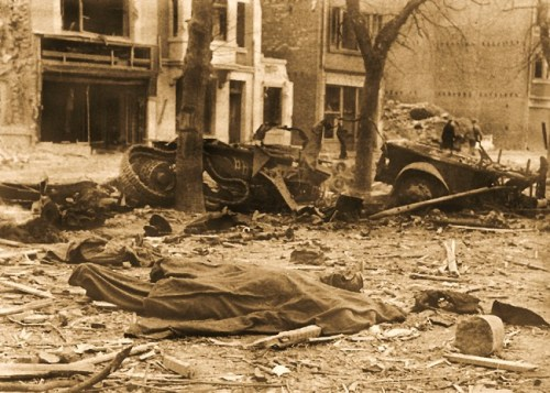 A BASTOGNE STREET AFTER LUFTWAFFE BOMBARDMENT