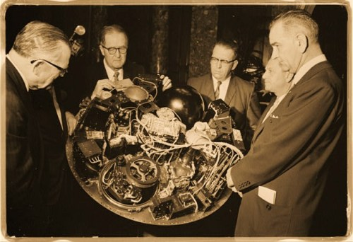 William G. Stroud of NASA, project manager of the TIROS I, displaying the satellite circuitry to Lyndon B. Johnson and others