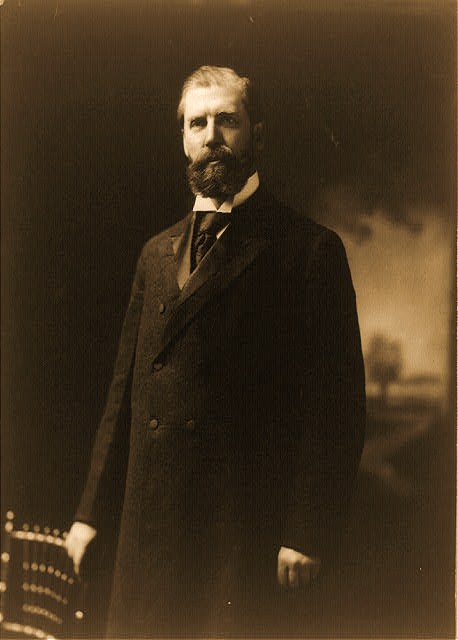 Charles Evans Hughes, three-quarter length portrait, standing, facing left [1908]