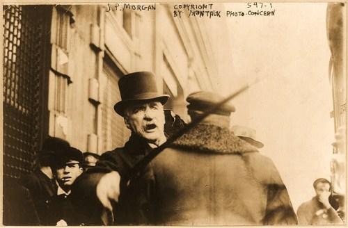 J.P. Morgan striking photographer with cane.