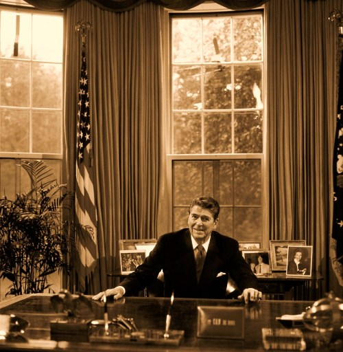 President Ronald Reagan at his desk in the Oval Office, Washington, D.C.