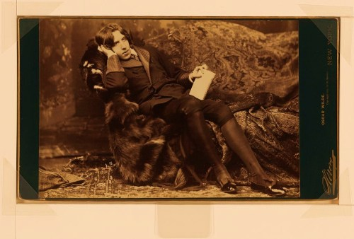 "Oscar Wilde, full-length portrait, facing right, sitting in chair, right hand on cheek, left hand holding book. Exhibited in ""Oscar Wilde: the Apostle of Beauty, Haggerty Museum of Art, Marquette University, 1999."