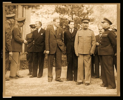 Teheran, Iran. Dec. 1943. Standing outside the Russian Embassy, left to right: unidentified British officer, General George C. Marshall, Chief of staff of USA, shaking hands with Sir Archibald Clark Keer, British Ambassador to the USSR, Harry Hopkins, Marshal Stalin's interpreter, Marshal Josef Stalin, Foreign minister Molotov, General Voroshilov. Picture was taken during the Teheran conference